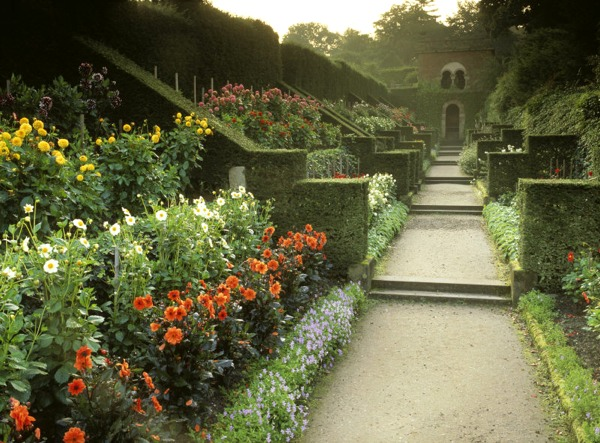 Looking down the Dahlia walk to the Shelter House at Biddulph Grange, with the yew hedges and butresses on the left. The walk laid out by James Bateman in 1842 was restored in 1988.