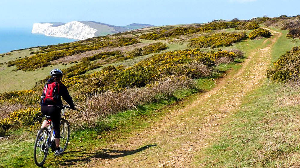 Cyclist on Compton Downs Isle of Wight - National Trust