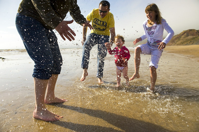 Family paddling at Compton Bay beach Isle of Wight - National Trust