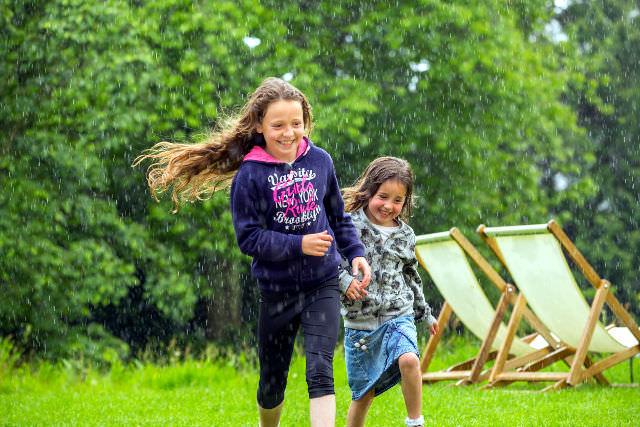 Children playing in the gardens at Greenway, Devon